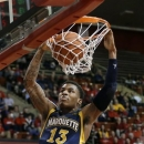 Marquette's Vander Blue dunks during the first half of an NCAA college basketball game against Rutgers on Tuesday, March 5, 2013, in Piscataway, N.J. (AP Photo/Mel Evans)