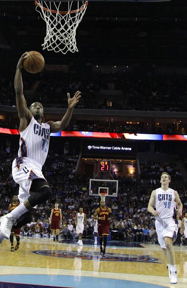 Charlotte Bobcats' Kemba Walker (15) drives to the basket against the Cleveland Cavaliers in the second half of an NBA basketball game in Charlotte, N.C., Friday, Nov. 1, 2013. The Bobcats won 90-84