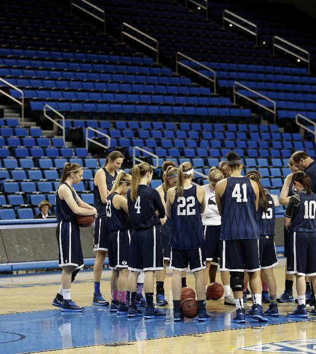 BYU players and coaches gather to pray before practice at the NCAA women's college basketball tournament on Friday, March 21, 2014, in Los Angeles. BYU is scheduled to play North Carolina State in a first-round game on Saturday
