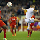 Real Madrid's Pepe, right, battles for the ball with Liverpool's Mario Balotelli during the Champions League group B soccer match between Liverpool and Real Madrid at Anfield Stadium, Liverpool, England, Wednesday Oct. 22, 2014