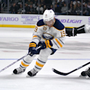 Buffalo Sabres center Cody Hodgson, left, battles for the puck with Los Angeles Kings defenseman Drew Doughty during the third period of an NHL hockey game, Thursday, Oct. 23, 2014, in Los Angeles. The Kings won 2-0 The Associated Press