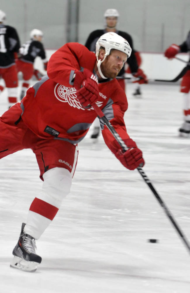 Detroit Red Wings' Johan Franzen shoots the puck during the NHL hockey training camp in Traverse City, Mich., Saturday, Sept. 14, 2013