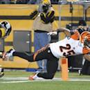 Cincinnati Bengals running back Giovani Bernard (25) leaps for the end zone past Pittsburgh Steelers free safety Mike Mitchell (23) and scores a touchdown during the first quarter an NFL football game, Sunday, Dec. 28, 2014 in Pittsburgh. (AP Photo/Don Wright)