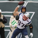 New England Patriots tight end Rob Gronkowski (87) spikes the football after scoring a touchdown during the first half of an NFL football game against the New York Jets, Sunday, Dec. 21, 2014, in East Rutherford, N.J. (AP Photo/Julio Cortez)