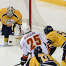 Nashville Predators goalie Pekka Rinne (35) blocks Calgary Flames left wing Brandon Bollig (25) shot as he is defended by Predators defenseman Roman Josi (59) in the second period of an NHL hockey game Tuesday, Oct. 14, 2014, in Nashville, Tenn The Associ