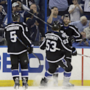 Tampa Bay Lightning right wing Brett Connolly (14, right) celebrates his goal against the Columbus Blue Jackets with teammates defenseman Luke Witkowski (53) and defenseman Jason Garrison (5) during the first period of an NHL hockey game Saturday, Jan. 31