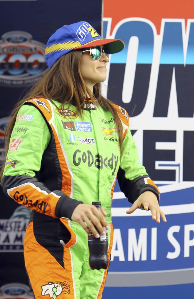 Danica Patrick wears a Jeff Gordon tribute cap during the driver introductions for the NASCAR Sprint Cup Series auto race, Sunday, Nov. 22, 2015, at Homestead-Miami Speedway in Homestead, Fla. (AP Photo/David  Graham)