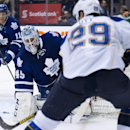 Toronto Maple Leafs goalie Jonathan Bernier, center, makes a save on St. Louis Blues forward Steve Ott (29) during the first period of an NHL hockey game Tuesday, March 25, 2014, in Toronto The Associated Press