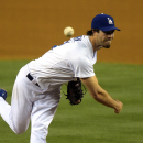 In this May 12, 2014, file photo, Los Angeles Dodgers starting pitcher Dan Haren throws to the plate during the third inning of a baseball game against the Miami Marlins in Los Angeles. With spring training barely six weeks away, it's uncertain whether or