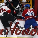 Montreal Canadiens center Ryan White (53) checks Ottawa Senators left wing Matt Kassian (28) into the bench during third-peri