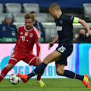 Bayern's Mario Goetze, left, and Manchester United's Nemanja Vidic, right, challenge for the ball during the Champions League quarterfinal second leg soccer match between Bayern Munich and Manchester United in the Allianz Arena in Munich, Germany, Wednesd
