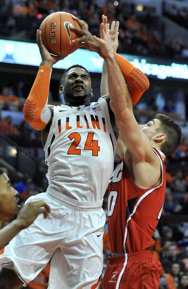 Illinois' Ravonte Rice (24) goes up for a shot against Illinois-Chicago's Jake Wiegeand (40) during the first half of an NCAA college basketball game in Chicago, Saturday, Dec., 28, 2013