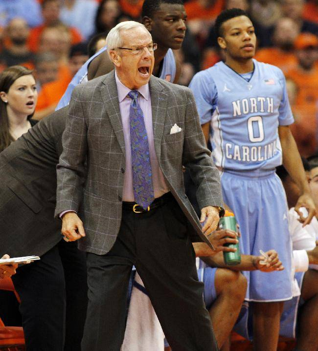 North Carolina's head coach Roy Williams, center, yells to his players in the first half of an NCAA college basketball game against Syracuse in Syracuse, N.Y., Saturday, Jan. 11, 2014
