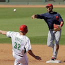 Cleveland Indians shortstop Mike Aviles, right, throws over Cincinnati Reds' Jay Bruce (32) to complete a double play on Reds' Ryan Ludwick in the fifth inning of a spring exhibition baseball game Monday, March 17, 2014, in Goodyear, Ariz The Associated P