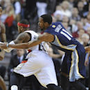 Memphis Grizzlies' Mike Conley (11) knocks the ball away from Portland Trail Blazers' Mo Williams (25) during the first half of an NBA basketball game in Portland, Ore., Sunday March 30, 2014 The Associated Press