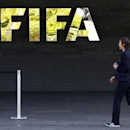 A staff walks past a logo of soccer's international governing body FIFA at their headquarters in Zurich, Switzerland, May 27, 2015.  REUTERS/Ruben Sprich