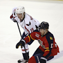 Washington Capitals' Nicklas Backstrom (19) and Florida Panthers' Jess Winchester (17) chase the puck during the first period of an NHL hockey game, Thursday, Feb. 27, 2014, in Sunrise, Fla The Associated Press