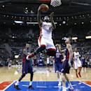 Miami Heat small forward LeBron James (6) drives against the Detroit Pistons in the second half of an NBA basketball game in Auburn Hills, Mich., Sunday, Dec. 8, 2013.  (AP Photo/Paul Sancya)
