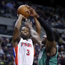 Detroit Pistons guard Rodney Stuckey (3) takes a shot against Boston Celtics forward Jeff Green (8) during the first half of an NBA basketball game Saturday, April 5, 2014, in Auburn Hills, Mich. Stuckey led the Pistons with 26 points in a 115-111 win The