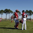 Washington Nationals catcher Wilson Ramos, left, talks with starting pitcher Gio Gonzalez, after Gonzalez pitched to Ramos, during a spring training baseball workout, Monday, Feb. 17, 2014, in Viera, Fla The Associated Press