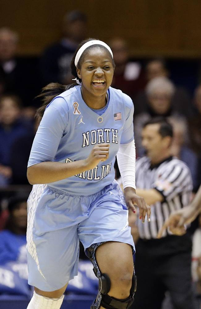 North Carolina's Stephanie Mavunga, center, reacts following a basket against Duke during the first half of an NCAA college basketball game in Durham, N.C., Monday, Feb. 10, 2014. North Carolina won 89-78