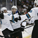 Ducks beat Sharks 5-2, clinch Pacific title The Associated Press