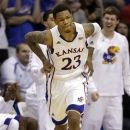 Kansas guard Ben McLemore (23) celebrates a 3-pointer during the second half of an NCAA college basketball game against West Virginia in Lawrence, Kan., Saturday, March 2, 2013. McLemore scored 36 points in the game. Kansas defeated West Virginia 91-65. (AP Photo/Orlin Wagner)