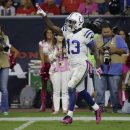 In this Oct. 9, 2014, file photo, Indianapolis Colts' T.Y. Hilton (13) celebrates during the first quarter of an NFL football game against the Houston Texans in Houston. Hilton isn't taking a backseat to anyone these days. He followed up a 200-yard game i