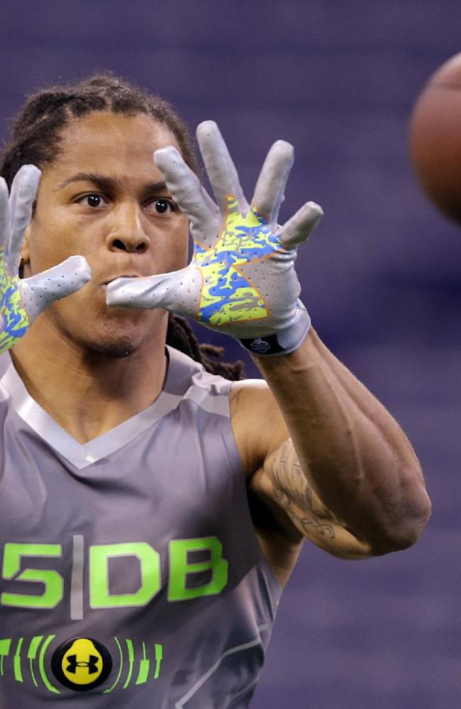 Texas Christian defensive back Jason Verrett makes a catch as he runs a drill at the NFL football scouting combine in Indianapolis, Tuesday, Feb. 25, 2014