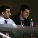 New Jersey Devils right wing Stephen Gionta, left, and defenseman Eric Gelinas sit in a luxury box while watching the third period of an NHL hockey game between the Devils and the Florida Panthers, Saturday, Jan. 31, 2015, in Newark, N.J. The Devils won 3