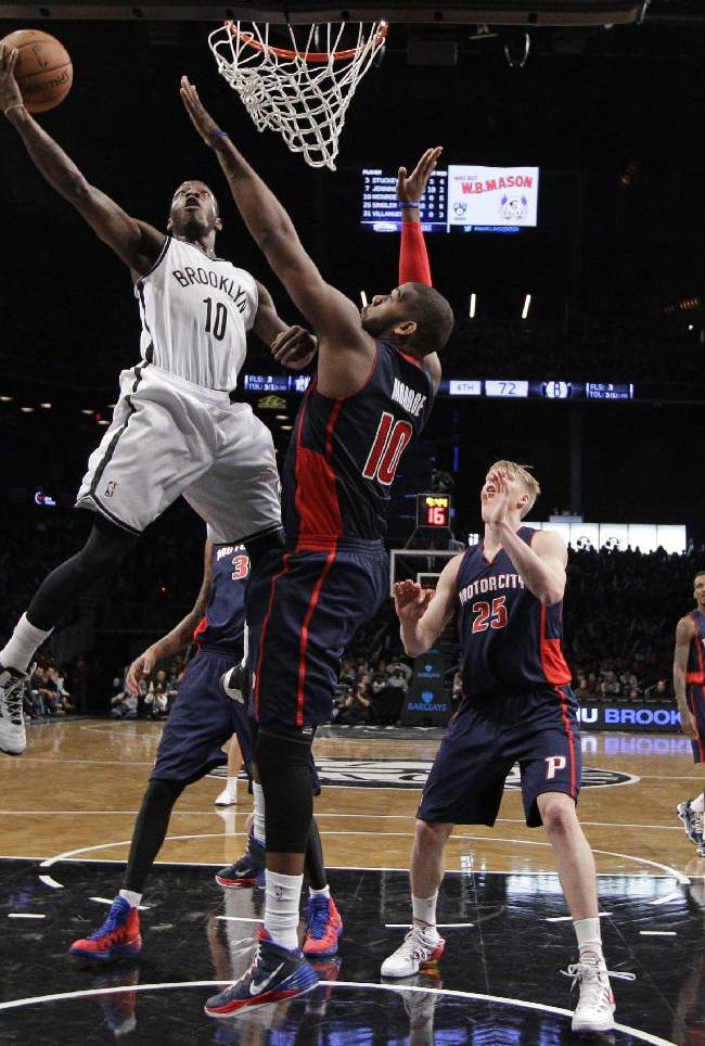 Brooklyn Nets guard Tyshawn Taylor (10)  goes up for a layup against Detroit Pistons forward Greg Monroe (10) in the second half of an NBA basketball game, Sunday, Nov. 24, 2013, in New York. The Pistons won 109-97