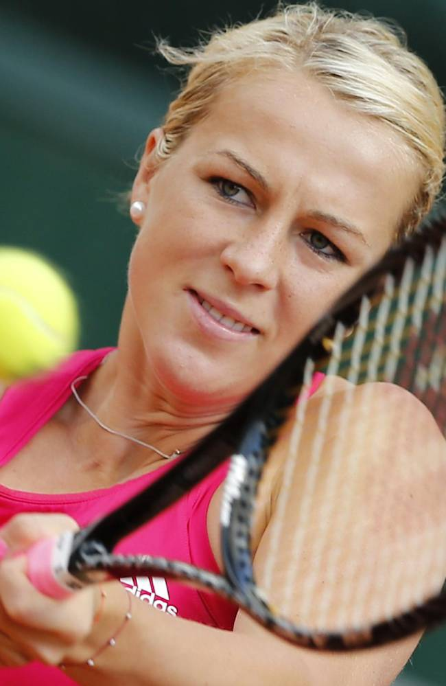Russia's Anastasia Pavlyuchenkova returns the ball during the second round match of the French Open tennis tournament against Netherlands' Kiki Bertens at the Roland Garros stadium, in Paris, France, Thursday, May 29, 2014