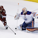 Edmonton Oilers goalie Ben Scrivens (30) makes a save on a shot by Phoenix Coyotes' Martin Erat (10), of the Czech Republic, during the third period of an NHL hockey game, Friday, April 4, 2014, in Glendale, Ariz. The Oilers defeated the Coyotes in a shoo