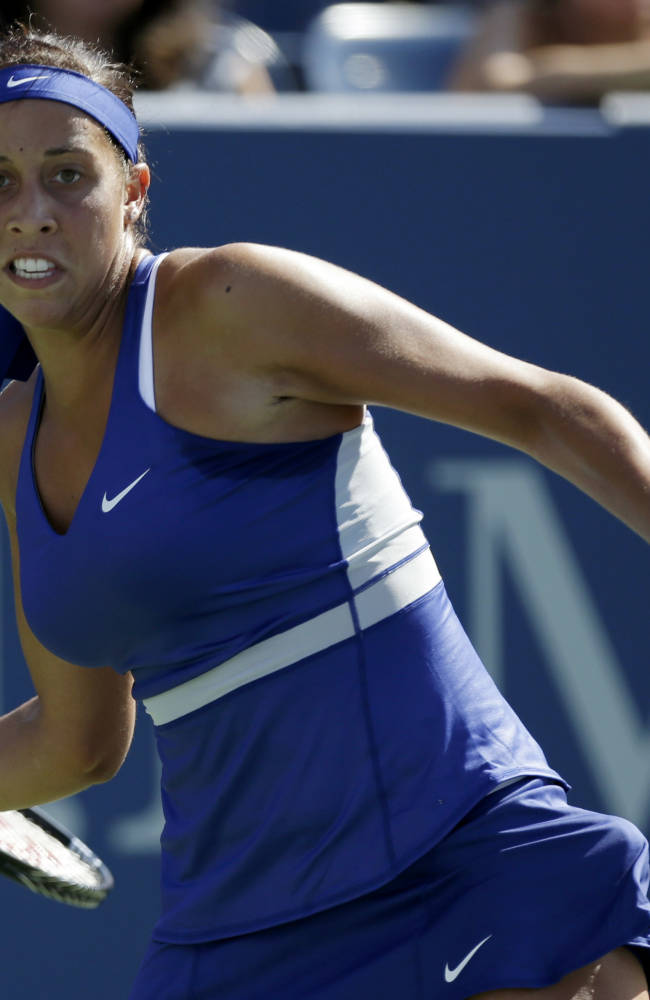 Madison Keys, of the United States, returns a shot against Aleksandra Krunic, of Serbia, during the second round of the 2014 U.S. Open tennis tournament, Thursday, Aug. 28, 2014, in New York
