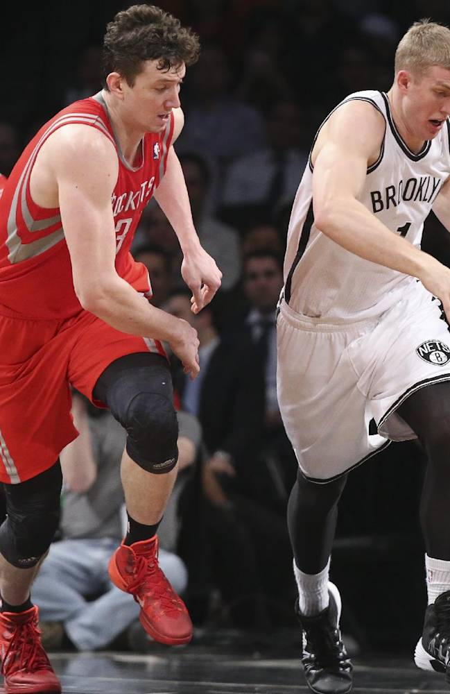 Brooklyn Nets forward Mason Plumlee (1) and Houston Rockets center Omer Asik (3) chase a rebound during the first half of their NBA basketball game at the Barclays Center, Tuesday, April 1, 2014, in New York