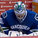 Vancouver Canucks goalie Ryan Miller pauses for a moment during the final seconds of the third period of an NHL hockey game against the Arizona Coyotes in Vancouver, British Columbia, Monday, Sept. 29, 2014 The Associated Press