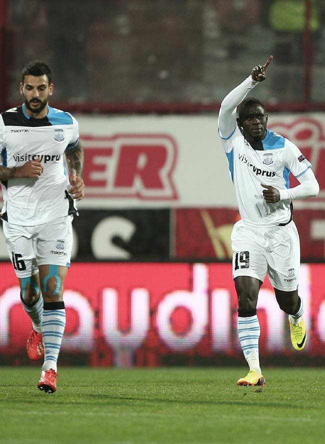 Soccer players of Apollon Limassol, with Guie Gneki Abraham pointing, celebrate their goal their Europa League Group J soccer match with Trabzonspor in Trabzon, Turkey, Thursday, Nov. 28, 2013.(AP Photo)
