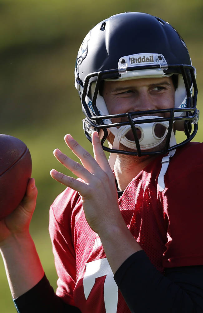Jacksonville Jaguars' quarterback Chad Henne throws a ball during their football practice at the Pennyhill Park Hotel and Spa in Bagshot, England, Wednesday, Oct. 23, 2013. The Jaguars face the San Francisco 49ers on Sunday in a NFL football game at Wembley Stadium in London