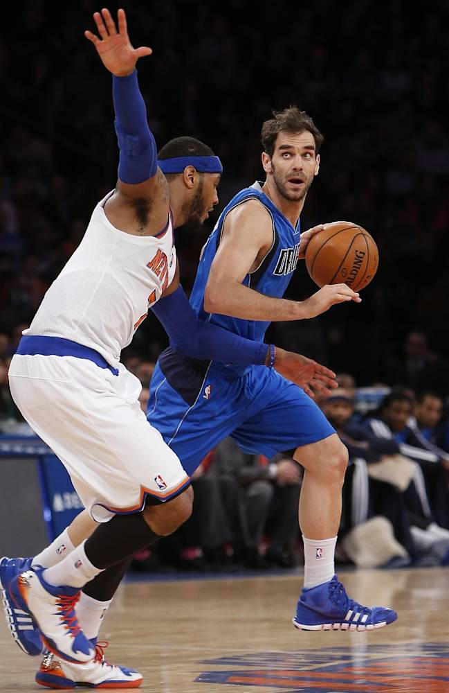 Dallas Mavericks' Jose Calderon, right, of Spain, drives against New York Knicks' Carmelo Anthony during the second half of an NBA basketball game, Monday, Feb. 24, 2014, in New York. Dallas won 110-108