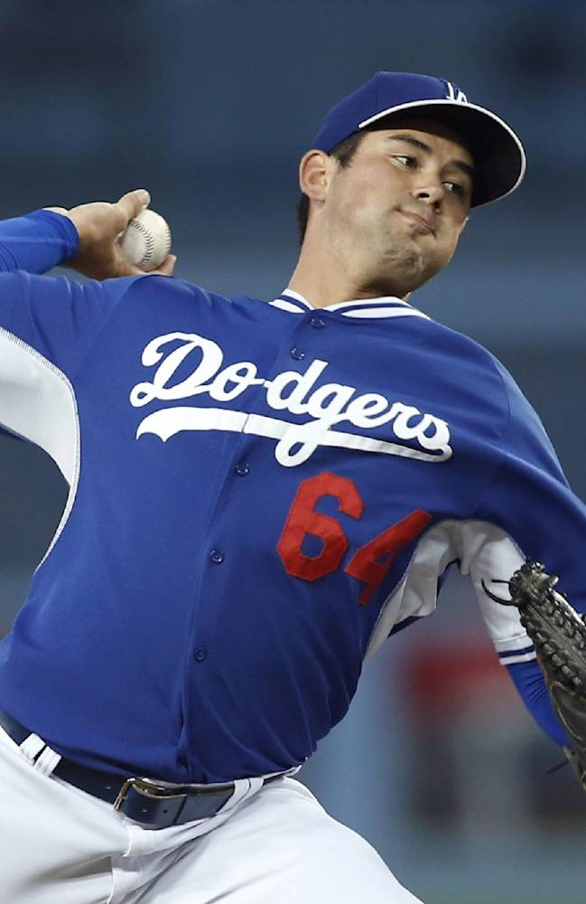 Los Angeles Dodgers starting pitcher Zach Lee delivers against the Los Angeles Angels during the first inning of an exhibition baseball game in Los Angeles, Friday, March 28, 2014