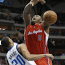 Los Angeles Clippers forward Glen Davis (0) loses control of the ball against Dallas Mavericks guard Devin Harris (20) during the first half of an NBA basketball game Thursday, March 27, 2014, in Dallas The Associated Press