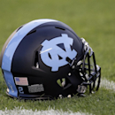 A North Carolina helmet is shown on the field prior to an NCAA college football game against Georgia Tech in Chapel Hill, N.C., Saturday, Oct. 18, 2014. (AP Photo/Gerry Broome)