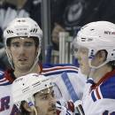 New York Rangers' Derick Brassard (16) is congratulated by teammates after scoring against the Winnipeg Jets during the second period of an NHL hockey game Tuesday, March 31, 2015, in Winnipeg, Manitoba. (AP Photo/The Canadian Press, John Woods)