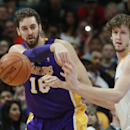 Los Angeles Lakers center Paul Gasol, left, of Spain, passes ball as Denver Nuggets forward jan Vesely, of the Czech Republic, covers in the fourth quarter of the Nuggets' 134-126 victory in an NBA basketball game in Denver on Friday, March 7, 2014 The As