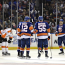 New York Islanders defenseman Nick Leddy (2), left wing Josh Bailey (12), defenseman Johnny Boychuk (55) and center John Tavares (91) celebrate Leddy's goal as Philadelphia Flyers left wing R.J. Umberger (18) reacts in the third period of an NHL hockey g
