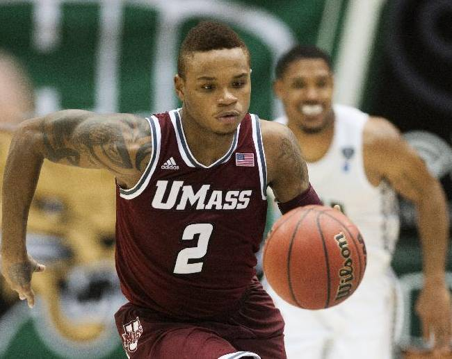 Massachusetts guard Derrick Gordon (2) makes his way downcourt against Ohio in the second half of an NCAA college basketball game on Wednesday, Dec. 18, 2013, in Athens, Ohio. UMass won 83-71