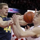 Michigan's Max Bielfeldt, left, and Wisconsin's Sam Dekker vie for a rebound during the first half of an NCAA college basketball game Saturday, Feb. 9, 2013, in Madison, Wis. (AP Photo/Andy Manis)