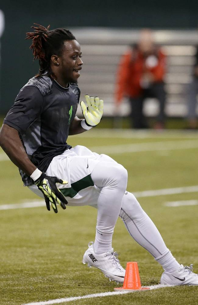 Wide receiver Tevin Reese maneuvers through cones in position-specific drills during pro day for NFL football representatives at Baylor University, Wednesday, March 19, 2014, in Waco, Texas