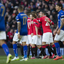 Manchester United's Daley Blind, center, celebrates with teammates after forcing a Leicester own goal during the English Premier League soccer match between Manchester United and Leicester at Old Trafford Stadium, Manchester, England, Saturday Jan. 31, 20