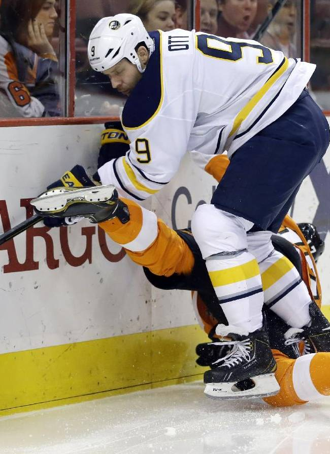 Buffalo Sabres' Steve Ott (9) checks Philadelphia Flyers' Wayne Simmonds into the boards during the second period of an NHL hockey game Thursday, Nov. 21, 2013, in Philadelphia